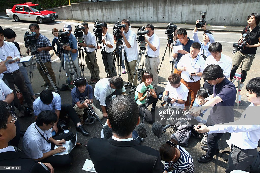 A school master of the high school explains the atmosphere of an emergency meeting after a 15- year-old girl killed her classmate and dismembered the body on July 28, 2014 in Sasebo, Nagasaki, Japan. According to the Nagasaki prefectural police, the student repeatedly struck the back of Aiwa Matsuo's head with a hand tool and strangled her with a rope in her apartment between 8 p.m. to 10 p.m. on July 26. Police confirmed the cause of death to be suffocation by cervical compression.
