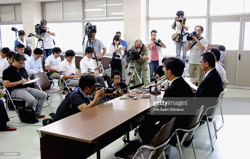 School masters and teachers hold a press conference a day after a 15-year-old girl killed her classmate on July 28, 2014 in Sasebo, Nagasaki, Japan. According to the Nagasaki prefectural police, the student repeatedly struck the back of Aiwa Matsuo's head with a hand tool and strangled her with a rope in her apartment between 8 p.m. to 10 p.m. on July 26. Police confirmed the cause of death to be suffocation by cervical compression.