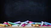 School or college blackboard background with colourful chalk, toned