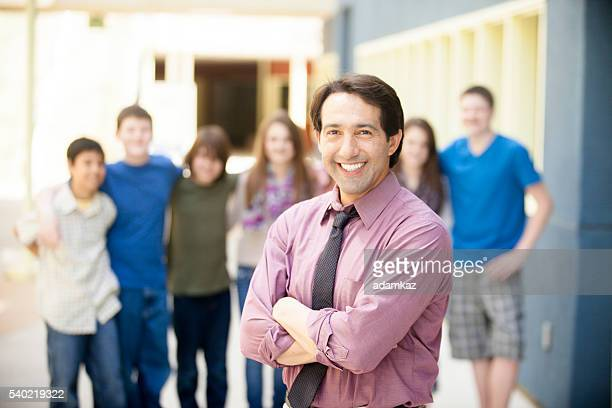 School Principal Smiling in front of students on campus