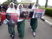 School pupils hold signs as members of Lagos based civil society groups hold rally calling for the release of missing Chibok school girls at the...