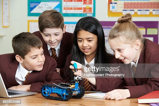 School Pupils In Science Lesson Studying Robotics : Stock Photo