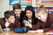 School Pupils In Science Lesson Studying Robotics