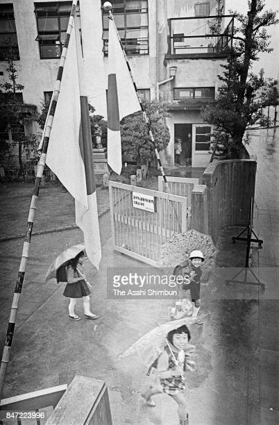 School pupils leave their school on the centenary day of the start of Meiji era on October 23 1968 in Nagoya Aichi Japan