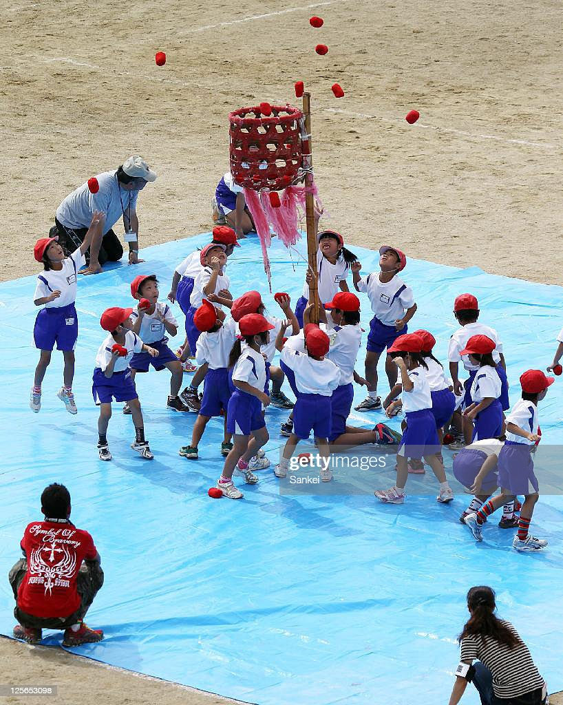 School pupils throw balls to the basket on the sheet to avoid the possible radiation exposure from the ground during their sports meet at Meitoku Primary School on September 17, 2011 in Kitaibaraki, Ibaraki, Japan. The school is located 80km southeast from the troubled Fukushima Daiichi Nuclear Power Plant.