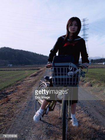 School School girl cycling : Stock Photo
