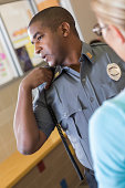 School security guard reporting incident in hallway