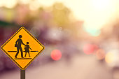 School sign on blur traffic road abstract background.Retro color style.