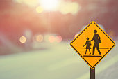 School sign.Traffic sign road on blur road abstract background.Retro color style.