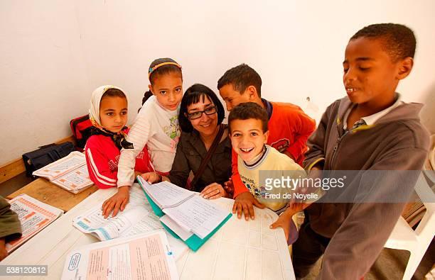 School Sponsor Visiting Moroccan Children in Classroom
