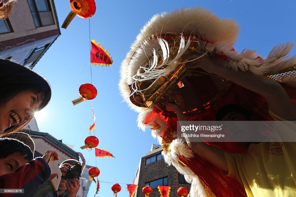 A school student performs lion dance as new year greet for tourists to celebrate the Chinese New Year at the Nankinmachi square, China Town on February 8, 2016 in Kobe, Japan. In Nankinmachi, the district known as Kobe Chinatown, tourists enjoyed Chinese food, lion dance and the parade organized to celebrate the Lunar New Year.