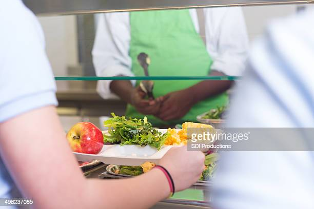 School students choosing variety of healthy foods in lunch line