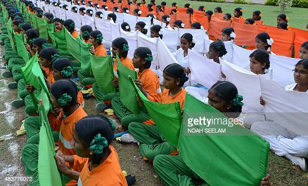 School students from the southern Indian state of Telangana display tri colour flags during a full dress rehearsal for the 69th Independence day...