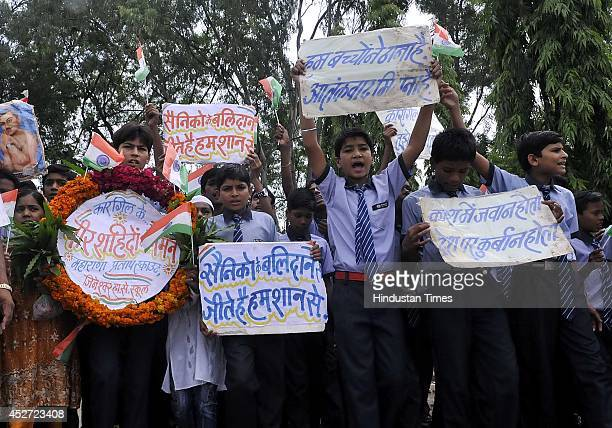 School students paying tribute to the soldiers who sacrificed their lives in Kargil war on the 15th Kargil Vijay Diwas at 15 th Battalion on July 26...