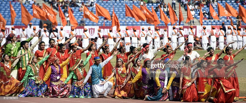 DAV School Student perform at a function to celebrate birth anniversary of Swami Dayanand Saraswati, the founder of the social reform movement Arya Samaj, on the presence of Prime Minister Narendra Modi with Acharya Dev Vrat, Governor of Himachal Pradesh Punam Suri and President DAV College Managing Committeeat Jawahar Lal Nehru stadium on February 14, 2016 in New Delhi, India. Rejecting opposition criticism over the state of the economy, Modi said as the world was grappling with financial crisis, India alone was 'progressing at a rapid pace' because of the policies of his government.