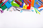 School supplies on a white background with copy space, top view
