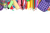 Colorful school supplies top border against a white background