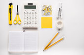 composition of white school supplies with opened blank notebook