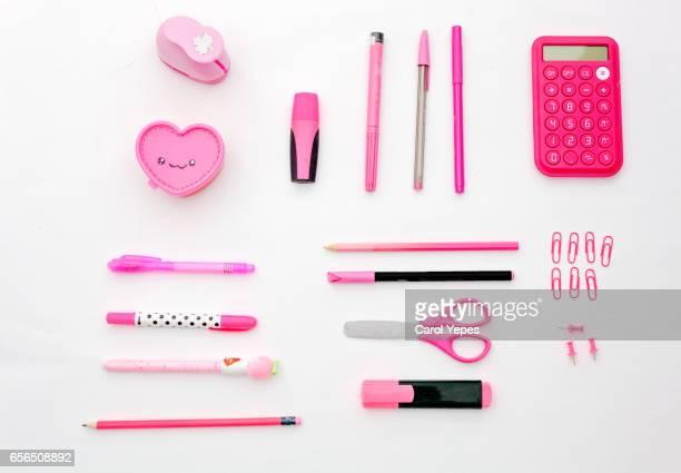 PINK school supplies.White background