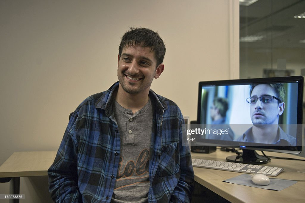 US school teacher, Andrew Cromeek smiles in front of a computer screen displaying a photo of himself playing Edward Snowden in 'Verax', the first film on the fugitive US intelligence leaker, during an interview with AFP in Hong Kong on July 2, 2013. Four amateur filmmakers in Hong Kong have beaten Hollywood to the draw by producing the first film on Edward Snowden, a five-minute thriller depicting the nail-biting intrigue surrounding the intelligence leaker when he was hiding in the city.