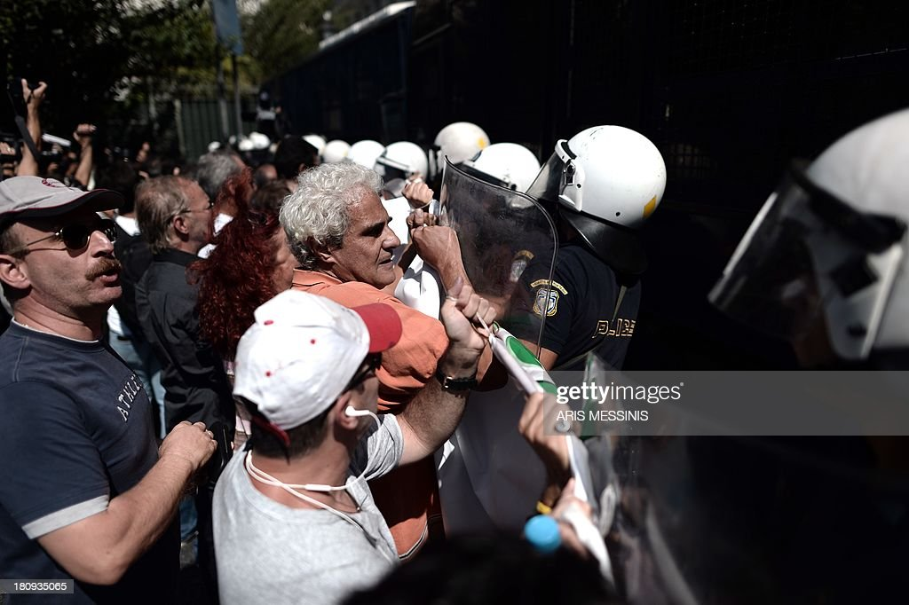 School teachers are blocked by riot police during a demonstration in central Athens on September 18, 2013. As part of the controversial redeployment plan in the country reeling from six years of recession, civil servants have to accept new posts or spend eight months on reduced salaries as alternative posts are found, with the risk of losing their jobs altogether.