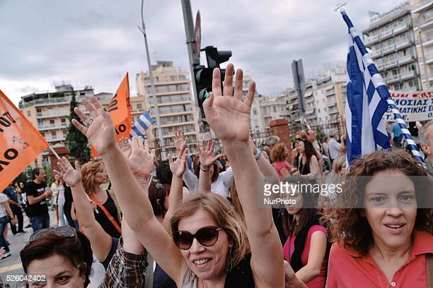 School teachers raise their hands while participating in a sit in protest outside the ministry of Macedonia and Thrace Hundreds of teachers gathered...