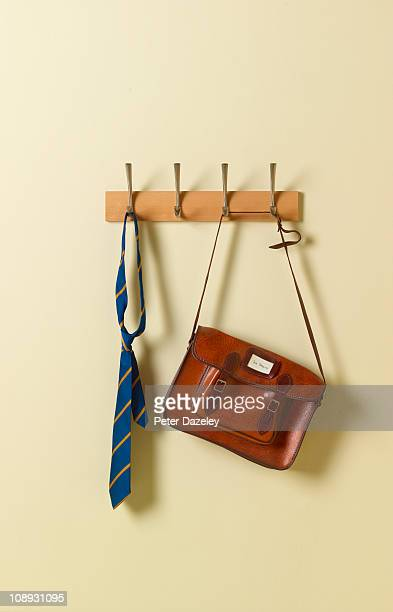 School tie and satchel on coat rack