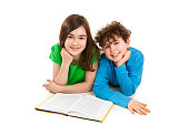 Girl and boy reading book