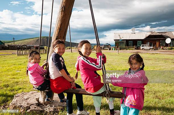 School-age girls on a swing