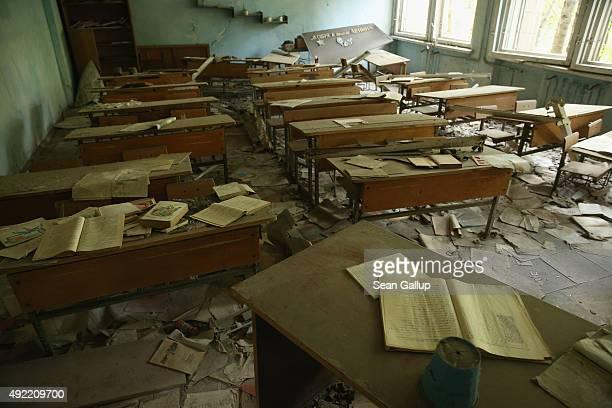 Schoolbooks lie on pupils' desks in a classroom of abandoned School Number 3 on September 30 2015 in Pripyat Ukraine Pripyat lies only a few...