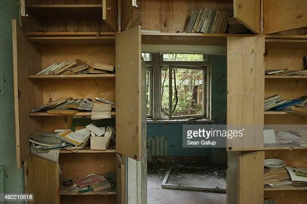 Schoolbooks lie on shelves in a classroom next to the door to a hallway of abandoned School Number 3 on September 30 2015 in Pripyat Ukraine Pripyat...