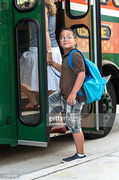 Schoolboy Boarding a Trolley, Holding Hands, with Backpack.
