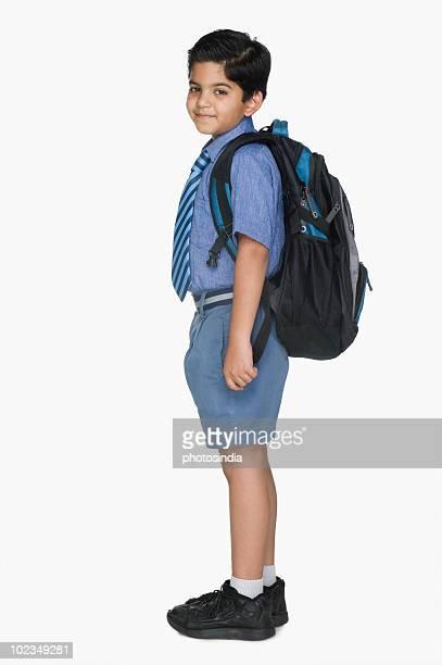 Schoolboy carrying a schoolbag