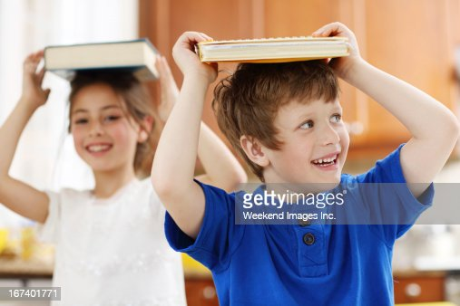 Schoolboy holding a book : Stock Photo