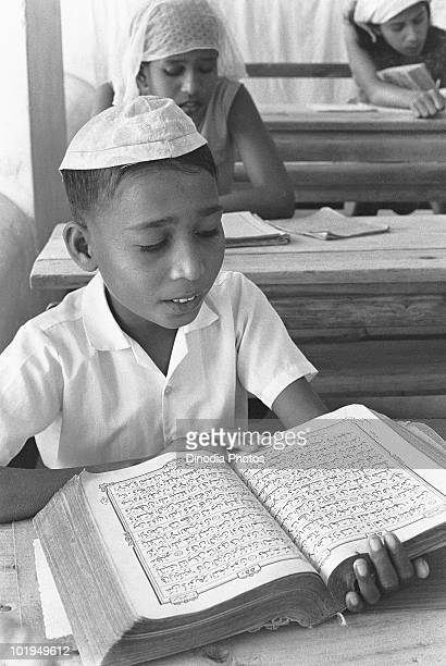 A schoolboy in class in the city of Male Maldives circa 1955