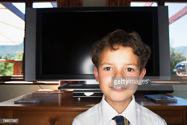 Schoolboy in Front of TV