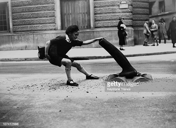 Schoolboy Playing With A Circulation Milestones In Paris On June 1935