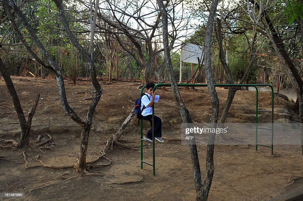 A schoolboy sits in a children's game in the yard of the Jean Paul Genie primary school during the year's first day of classes, in Managua, on February 11, 2013. AFP PHOTO/Hector RETAMAL
