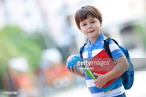 schoolboy with exercise books
