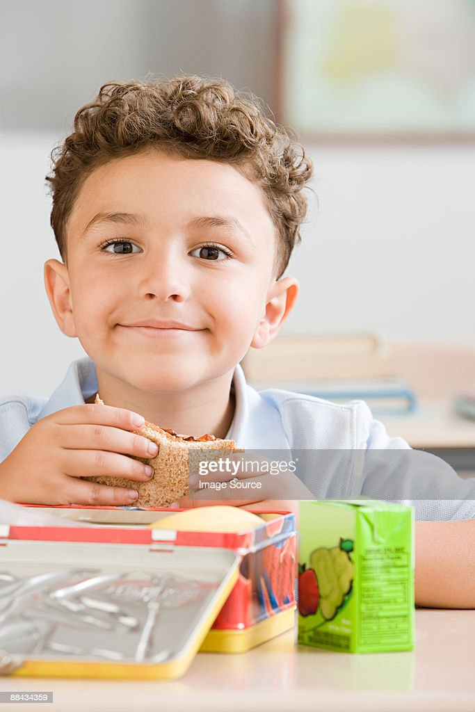 Schoolboy with packed lunch
