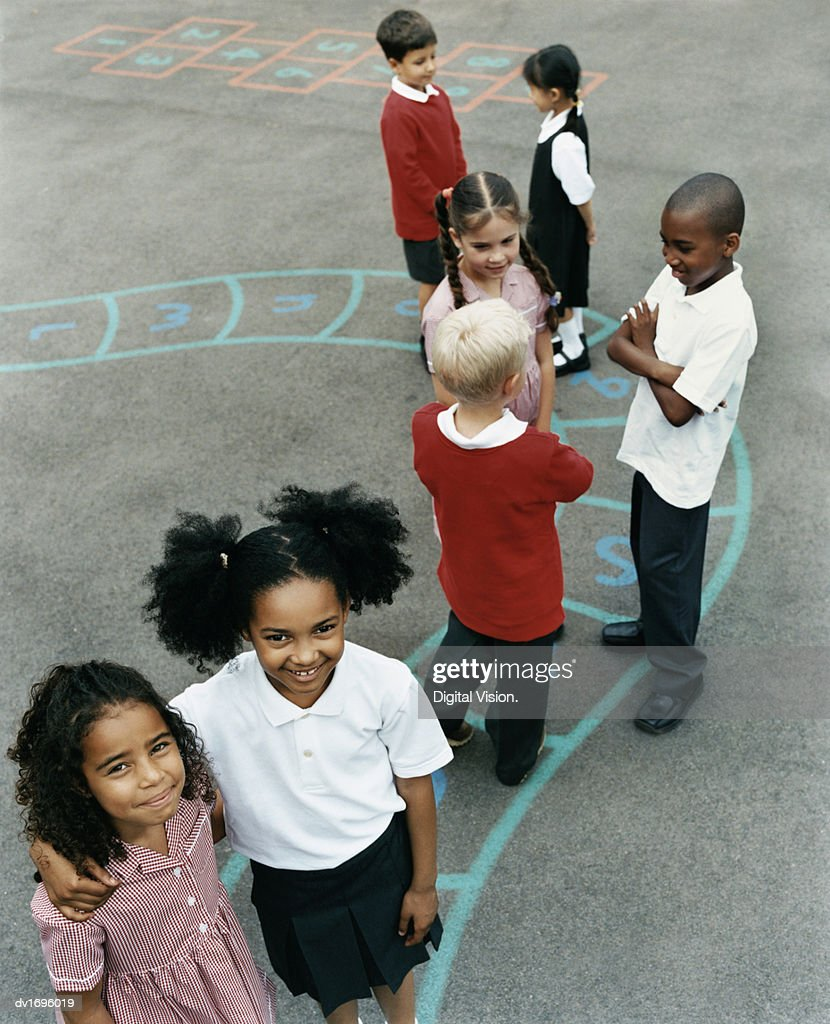 Schoolboys and Girls in a Playground : Stock Photo