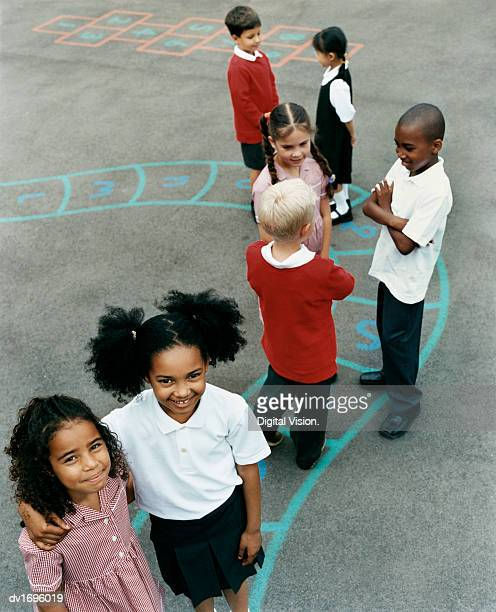 Schoolboys and Girls in a Playground