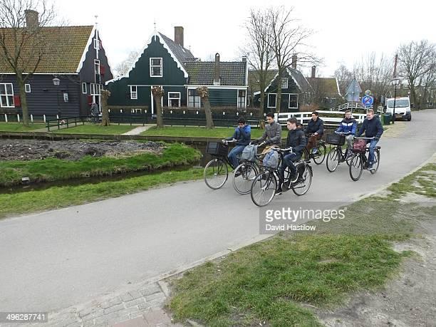 Schoolboys cycling in zaandam near Amsterdam