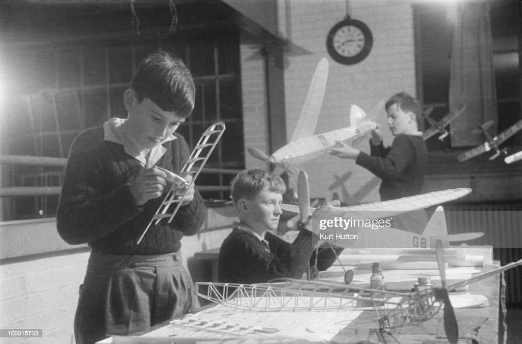 Schoolboys making model aeroplanes in the Hobbies Room at Bedales Boarding School in Steep, Hampshire, January 1941. Original publication: Picture Post - 403 - Bedales Boarding School - pub. 4th January 1941