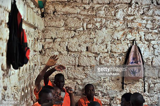 Schoolboys participate to a lesson in a classroom in Kilifi approximately 50 kilomtres northeast of Mombasa on June 23 where an initiative called...