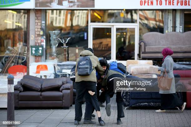 Schoolboys play boisterously on their way home from school in Soho Road Handsworth famous for its multicultural residents on March 23 2017 in...