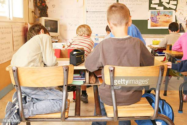 Schoolchild Photoessay in a mixtedgrade class with last year kindergarten and 1st grade Bad posture of a schoolboy