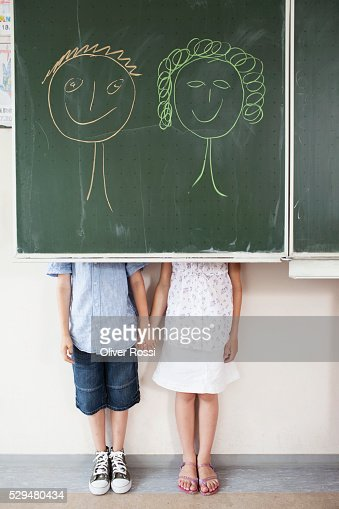 Schoolchildren and blackboard with smiley faces : ストックフォト