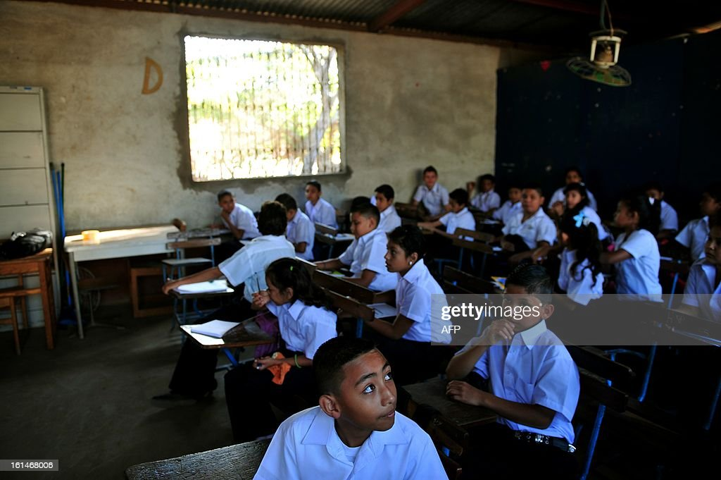 Schoolchildren attend a class at the Jean Paul Genie primary school during the year's first day of classes, in Managua, on February 11, 2013. AFP PHOTO/Hector RETAMAL