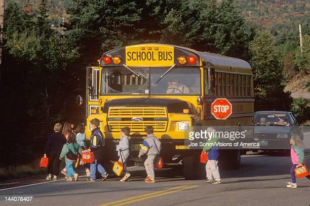 Schoolchildren boarding a schoolbus Cape Breton Novia Scotia